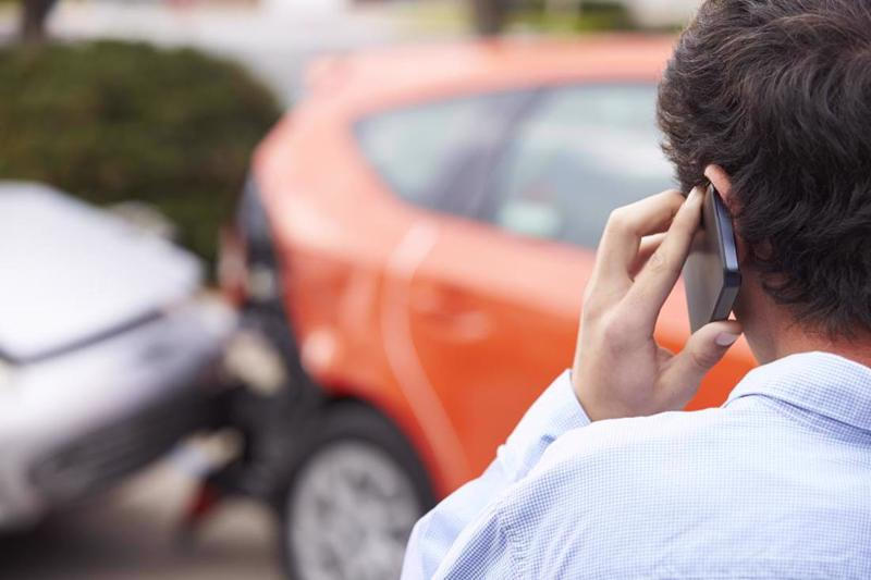 A man calling a lawyer after a car accident in Dayton.