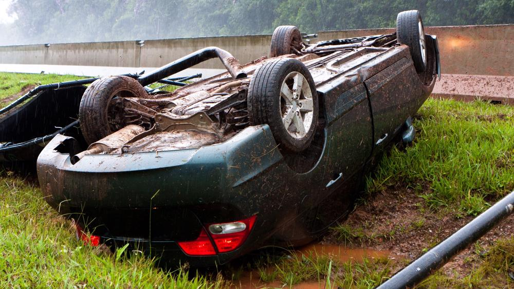 This image shows a car that has been overturned in Indiana