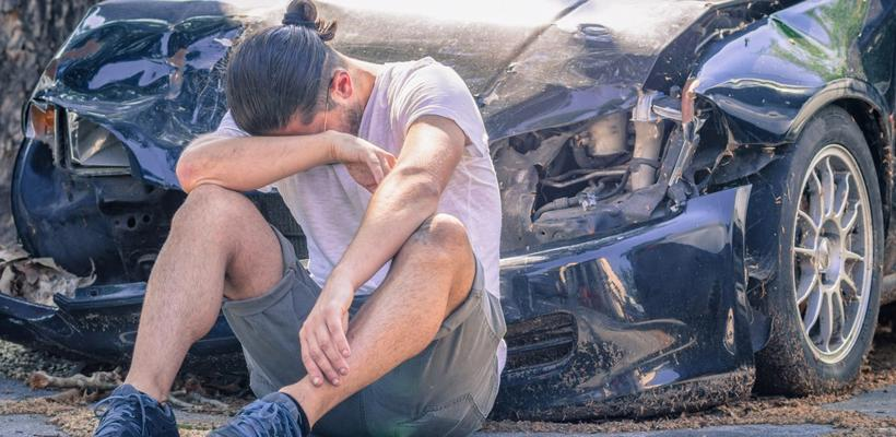 This image shows a man appearing flustered after a car accident in Kentucky