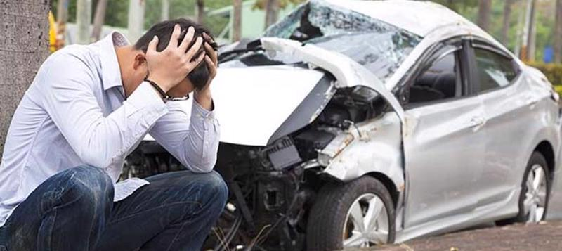 Man sits with his head in his hands after a car accident in Cincinnati