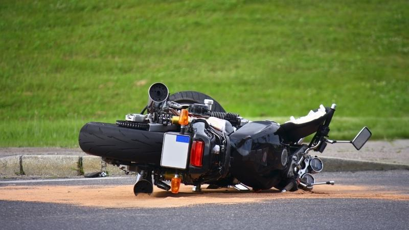 This image shows a motorcycle lying on the ground after an accident in Cincinnati, OH.