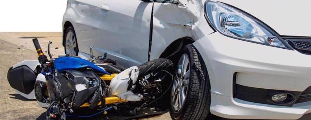 This image shows a motorcycle that has crashed into another vehicle in Cincinnati, OH.
