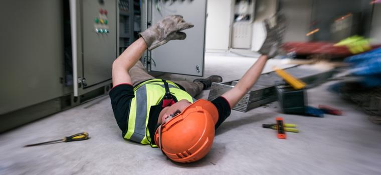 This image shows a man lying on the floor after an injury at work in Hamilton, Indiana.