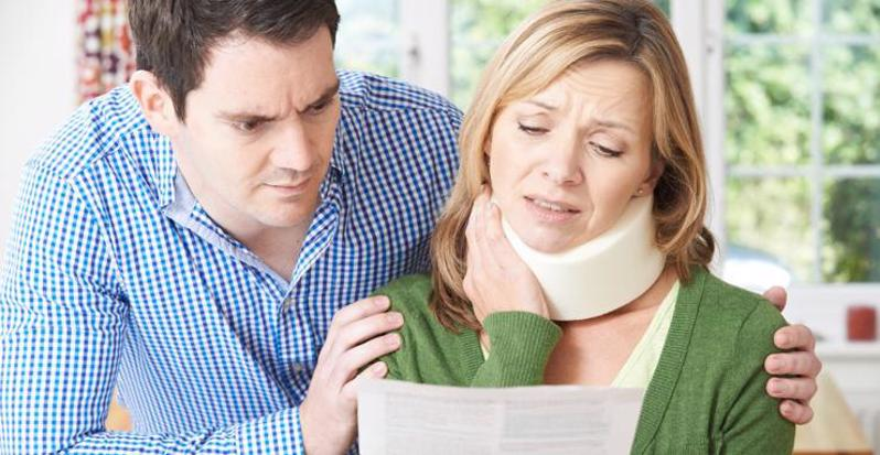 This image shows a couple reviewing their personal injury claim in Indiana.