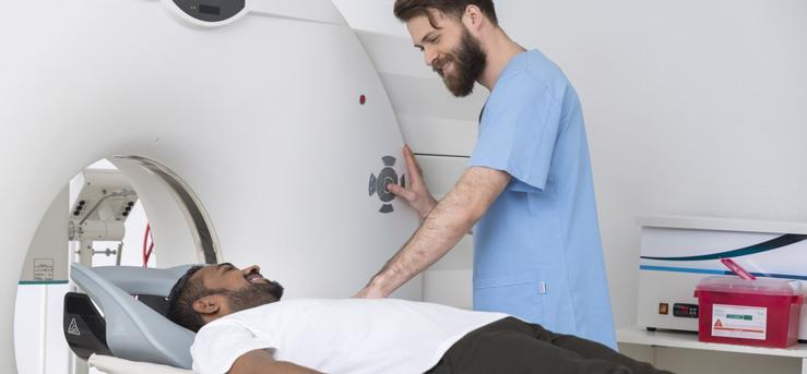This image shows a man about to get a ct scan