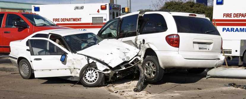 This image shows a car and a van that have been involved in a accident.