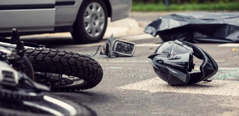 A motorcycle and helmet lying in the street after an accident with a car in Cincinnati.